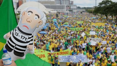 An inflatable figure in the likeness of Lula, former president of Brazil, is seen as demonstrators gather during a protest against Dilma Rousseff in Brasilia in March.