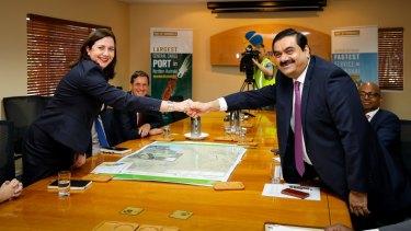 Queensland Premier Annastacia Palaszczuk pictured with Gautam Adani.