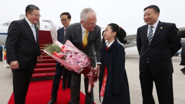 Prime Minister Malcolm Turnbull was presented with flowers on arrival in Shanghai.