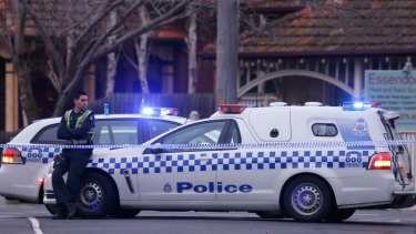 Police cars block Robinson Street in Moonee Ponds after an officer was shot during an intercept on July 7, 2015.