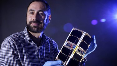 Elias Aboutanios with the EC0 mini-satellite, which is on its way into space.