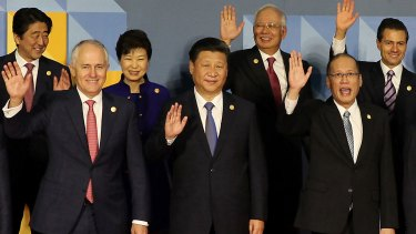Happier times? Leaders wave at the Asia-Pacific Economic Cooperation summit in Manila, Philippines in 2015. Pictured from top left, Japanese Prime Minister Shinzo Abe, South Korea President Park Geun-hye, Malaysian Prime Minister Najib Razak, and Mexican President Enrique Pena Nieto, front row from left, Australian Prime Minister Malcolm Turnbull, Chinese President Xi Jinping and Philippines President Benigno Aquino III.