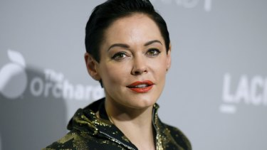 """FILE - In this April 15, 2015 file photo, Rose McGowan arrives at the LA Premiere Of """"DIOR & I"""" held at the Leo S. Bing Theatre in Los Angeles. McGowan emerged from a brief suspension on Twitter on Thursday, Oct. 12, 2017, to offer her most pointed accusation that she was sexually abused by film mogul Harvey Weinstein. Weinstein's representative says the producer denies he engaged in """"any non-consensual contact."""" (Photo by Richard Shotwell/Invision/AP, File)"""