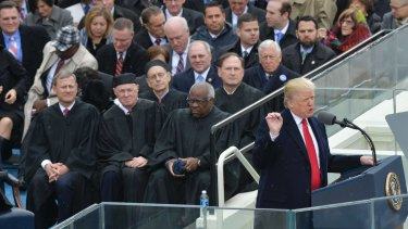 Donald Trump delivers his first address after being sworn in as the 45th president of the United States on Friday.