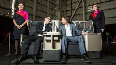 CEO Allan Joyce and designer Marc Newson demonstrate the features of the new 787-9 Dreamliner.