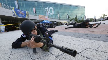South Korean police officers aim their machine guns during an anti-terror drill as part of Ulchi Freedom Guardian exercise, in Goyang, South Korea - part of US-South Korean drills.