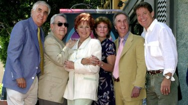 From left: Garry Marshall, Tom Bosley, Marion Ross, Erin Moran, Henry Winkler, and Anson Williams of <i>Happy Days</i> pose together in 2001.