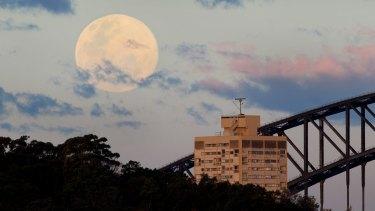 A supermoon rises over Sydney Harbour Bridge on August 10, 2014.