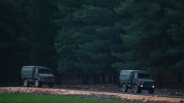 Turkish military trucks are driven on the outskirts of the village of Sugedigi, Turkey.