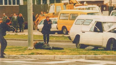 Hitman Stephen Asling lies prostrate as Special Operations Group members approach during Melbourne's underworld wars. The SOG trains for hundreds of violent scenarios.