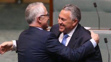 Prime Minister Turnbull embraces former treasurer Joe Hockey after his valedictory speech on Wednesday.