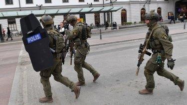 Heavily armed police arrive in central Stockholm.