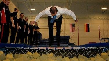 Tony Abbott demonstrating how to do a flip.