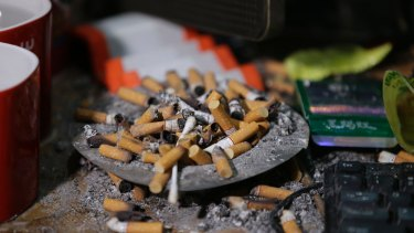 Cigarettes overflow from an ashtray in the home of suspected child webcam cybersex operator, David Timothy Deakin, in the Philippines.
