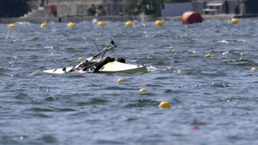A Serbian pair capsize while competing,