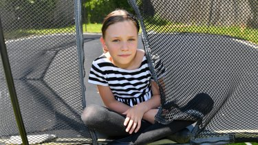 Orla Morrison-Brown, 9, broke both bones in her right arm getting off a trampoline.
