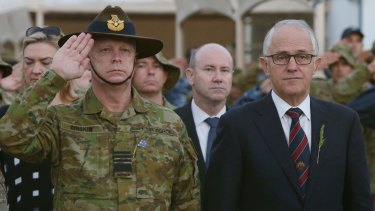 Malcolm Turnbull attends an Anzac Day ceremony at Australia's main base in the Middle East.