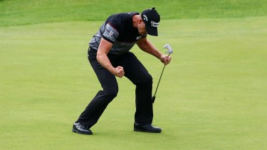 Henrik Stenson celebrates his British Open victory after his final putt at Royal Troon on Sunday.