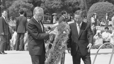 In 1984, guided by then-Hiroshima mayor Takeshi Araki, former president Jimmy Carter places a wreath at the memorial cenotaph, a monument containing the names of the dead in the 1945 atomic bombing of Hiroshima.