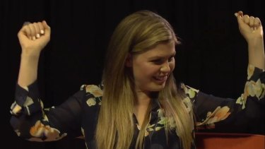 Belle Gibson as she appeared in a media coaching video with Penguin publishers.