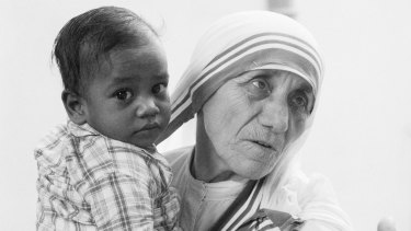 Mother Teresa holds a boy in a Kolkata orphanage, shortly after being awarded the 1979 Nobel Peace Prize.