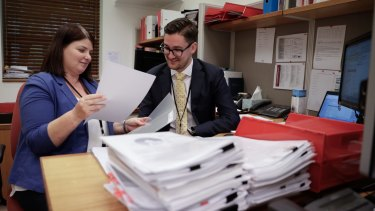Smith's staff members, Kelli Orrell and Kyle Regan, at their office at Parliament House.