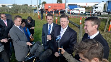 Former premier Denis Napthine, flanked by federal Infrastructure Minister Jamie Briggs and former transport minister Terry Mulder spruiking the East West Link.