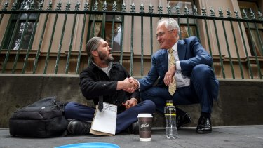 Prime Minister Malcolm Turnbull with homeless man Kent Kerswell in January.
