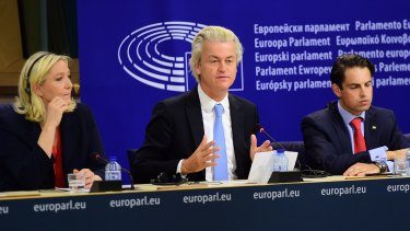 Geert Wilders (centre) of the Netherlands' Party for Freedom announces a new grouping of far-right parties at the European Parliament in Brussels with France's Marine Le Pen (left)  and Belgium's Tom van Grieken.