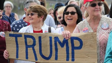 Supporters at  a campaign rally for Republican presidential candidate Donald Trump. History shows it doesn't matter who wins the race to the White House, despite the wobble on US sharemarkets whenever it appears Trump is doing well.