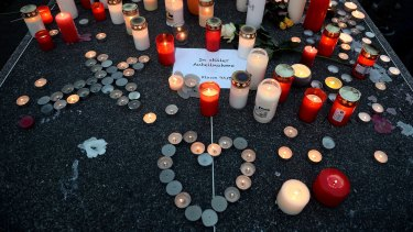Students and well wishers remember their friends at Joseph-Koenig Gymnasium secondary school in Haltern am See, Germany.