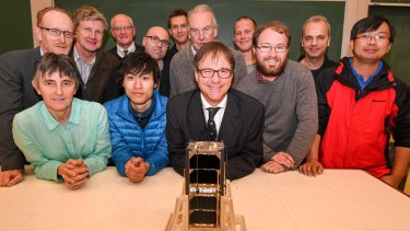 We have lift off: Project leader Iver Cairns with the Inspire-2 mini satellite and the team that built it.