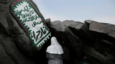 A Turkish Muslim woman prays inside Hiraa cave, where Prophet Muhammad received his first revelation from God to preach Islam, on Noor Mountain, on the outskirts of Mecca, Saudi Arabia.