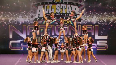 Perfect finish ... a team finale at the cheerleading championships.