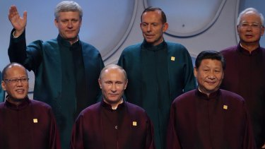 Prime Minister Tony Abbott between with Canadian Prime Minister Stephen Harper and Malysian leader Najib Tazak looks at Russian President Vladimir Putin. The two had a brief exchange in Beijing before more sideline talks at APEC. Chinese President Xi Jinping is to the right of Mr Putin.