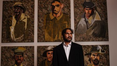 Vincent Namatjira, at Hazelhurst Arts Centre with part of his new work.