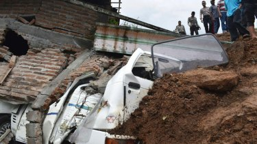 A disaster management official said rescue efforts were hampered by people flocking to the area to see the landslide and causing traffic jams.