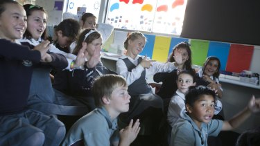 Grade 5 students from St Josephs Catholic Primary School in Mernda learning Chinese via Skype.