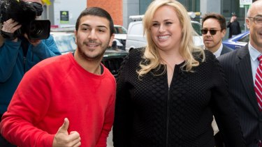 Actress Rebel Wilson stops for a photo with a fan as she arrived for her case at the Supreme Court in Melbourne.