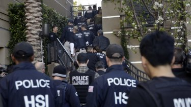 Federal agents raid the apartment complex in Orange County, California, where authorities say a birth tourism business charging pregnant women $US50,000 for lodging, food and transportation was operating.