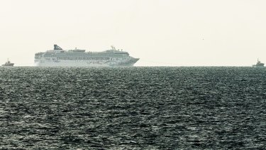The Norwegian Star being towed back to Melbourne as seen from Mornington Pier on Saturday afternoon.