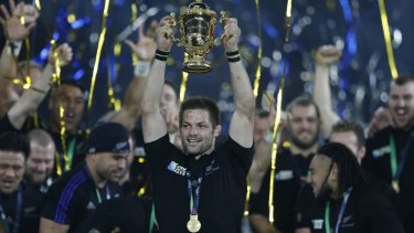 Winners: New Zealand's captain Richie McCaw holds up the World Cup.
