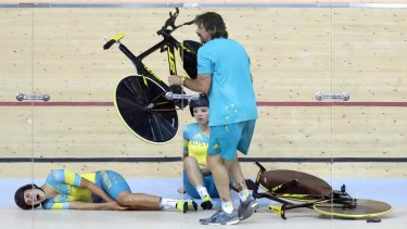 Horror start: Mel Hoskins cries out in pain after a training crash at the Rio velodrome.