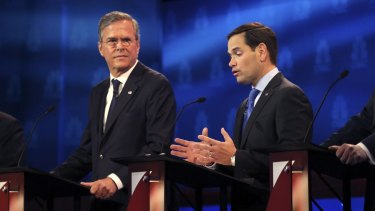 Marco Rubio speaks as Jeb Bush, left, listens during a debate of Republican presidential hopefuls at the University of Colorado in Boulder in October.