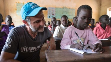 Hosseini visits students at Nyumanzi Integrated Primary School for Ugandan nationals and refugees from South Sudan.