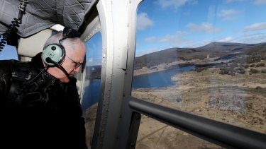 The Prime Minister during his aerial tour of the region via helicopter.