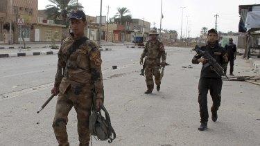 Iraq's elite counterterrorism forces enter downtown Hit on April 7.