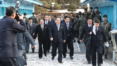 North Korean Ri Son-gwon, centre, arrives at the South side for the meeting with South Korea at the Panmunjom in the Demilitarized Zone in Paju.
