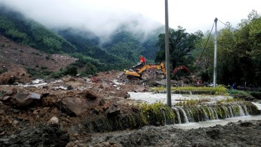 Rescuers search for survivors following a landslide in Sucun village in eastern China's Zhejiang Province in September 2016.