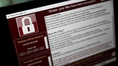 A lock screen from a cyber attack warns that data files have been encrypted.